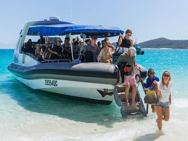 guests departing off zigzag on whitehaven beach
