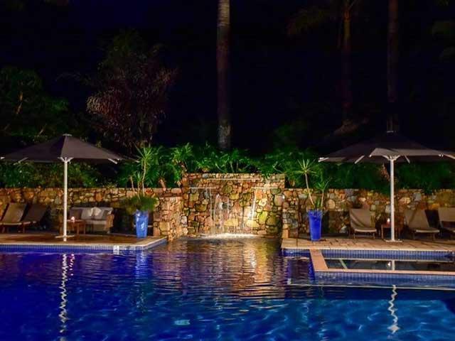 palm bay resort pool at night